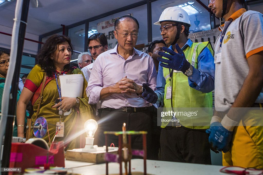 <a gi-track='captionPersonalityLinkClicked' href=/galleries/search?phrase=Jim+Yong+Kim&family=editorial&specificpeople=2302483 ng-click='$event.stopPropagation()'>Jim Yong Kim</a>, president of the World Bank Group, center, speaks to a supervisor during a visit to a vocational training class at the Infrastructure Leasing & Financial Services (IL&FS) Institute of Skills in New Delhi, India, on Wednesday, June 29, 2016. Kim arrived in India on June 28 for a two day visit. Photographer: Prashanth Vishwanathan/Bloomberg via Getty Images