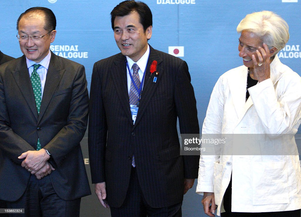 <a gi-track='captionPersonalityLinkClicked' href=/galleries/search?phrase=Jim+Yong+Kim&family=editorial&specificpeople=2302483 ng-click='$event.stopPropagation()'>Jim Yong Kim</a>, president of the World Bank Group, from left, Koriki Jojima, Japan's finance minister, center, and <a gi-track='captionPersonalityLinkClicked' href=/galleries/search?phrase=Christine+Lagarde&family=editorial&specificpeople=566337 ng-click='$event.stopPropagation()'>Christine Lagarde</a>, managing director of the International Monetary Fund (IMF), pose for a group photograph at the Sendai Dialogue on the sidelines of the Annual Meetings of the International Monetary Fund (IMF) and the World Bank Group in Sendai City, Miyagi Prefecture, Japan, on Wednesday, Oct. 10, 2012. The world's finance ministers and central bank governors are gathering this week in Tokyo for the annual meetings of the IMF and the World Bank as the rebound from the deepest global recession since World War II stagnates. Photographer: Tomohiro Ohsumi/Bloomberg via Getty Images