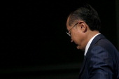 Jim Yong Kim president of the World Bank Group leaves the stage after a news conference at the Annual Meetings of the International Monetary Fund and...