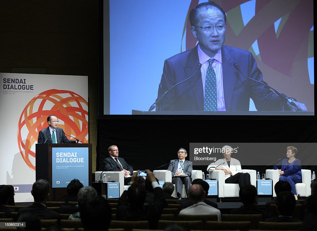 <a gi-track='captionPersonalityLinkClicked' href=/galleries/search?phrase=Jim+Yong+Kim&family=editorial&specificpeople=2302483 ng-click='$event.stopPropagation()'>Jim Yong Kim</a>, president of the World Bank Group, left, speaks as Mohamed Najib Boulif, Morocco's general affairs and governance minister, second left, <a gi-track='captionPersonalityLinkClicked' href=/galleries/search?phrase=Haruhiko+Kuroda&family=editorial&specificpeople=649295 ng-click='$event.stopPropagation()'>Haruhiko Kuroda</a>, president of the Asian Development Bank (ADB), center, <a gi-track='captionPersonalityLinkClicked' href=/galleries/search?phrase=Christine+Lagarde&family=editorial&specificpeople=566337 ng-click='$event.stopPropagation()'>Christine Lagarde</a>, managing director of the International Monetary Fund (IMF), second right, and Kristalina Georgieva, EU Commissioner for International Cooperation, Humanitarian Aid and Crisis Response, listen during a panel discussion at the Sendai Dialogue on the sidelines of the Annual Meetings of the International Monetary Fund (IMF) and the World Bank Group in Sendai City, Miyagi Prefecture, Japan, on Wednesday, Oct. 10, 2012. The world's finance ministers and central bank governors are gathering this week in Tokyo for the annual meetings of the IMF and the World Bank as the rebound from the deepest global recession since World War II stagnates. Photographer: Tomohiro Ohsumi/Bloomberg via Getty Images