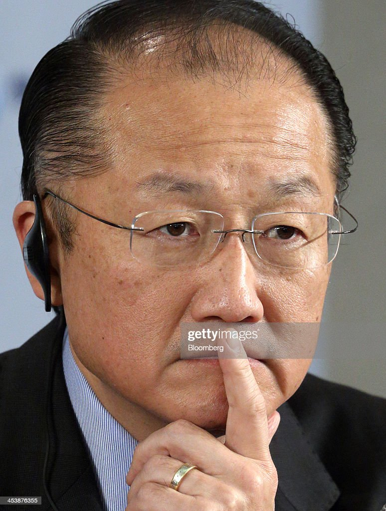 Jim Yong Kim president of the World Bank Group listens during a news conference with Taro Aso Japan's deputy prime minister and finance minister...