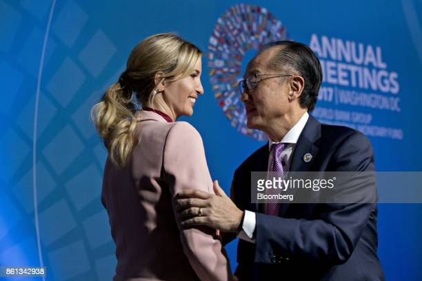 Jim Yong Kim president of the World Bank Group right greets Ivanka Trump assistant to US President Donald Trump on stage before the start of a panel...