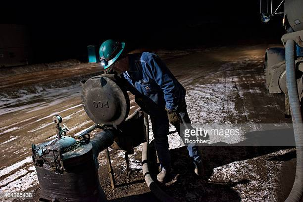 Jim Zumwalt a driver with Black Hills Trucking monitors a water tank as he unloads saltwater at a disposal facility near Sidney Montana US on...