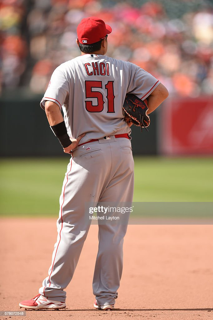 Ji-Man Choi #51 of the Los Angeles Angels of Anaheim looks on during a baseball game against the Baltimore Orioles at Oriole Park at Camden Yards on July 10, 2016 in Baltimore, Maryland. The Orioles won 4-2.