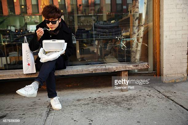 Jiman Do eats his lunch out of a styrofoam takeout container on December 19 2013 in New York City New York's City Council will vote Thursday on a...