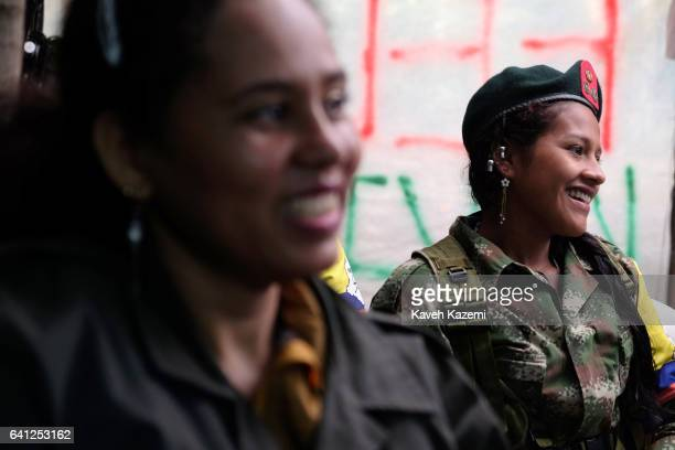Jimena a 18 years old female FARC guerrilla fighter wears pin up buttons with pictures of FARC leaders on her revolutionary style beret while...