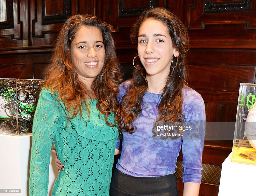 Jimena Paratcha (L), Founding Trustee of ABC TRUST, and daughter Jana Page attend 'The Art Of Futebol' charity auction in support of Action for Brazil's Children Trust at the Embassy of Brazil on July 10, 2014 in London, England.