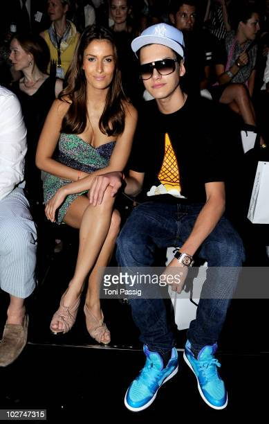 Jimi Bleu Ochsenknecht and girlfriend Joana sit in front row at the Designer For Tomorrow Show during the Mercedes Benz Fashion Week Spring/Summer...