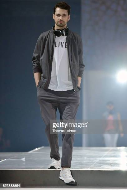 Jimi Blue Ochsenknecht dressed in 'sOliver Red Label' walks the runway for 'sOliver THE FUSION COLLECTION Fashion Show' at Festhalle on March 25 2017...
