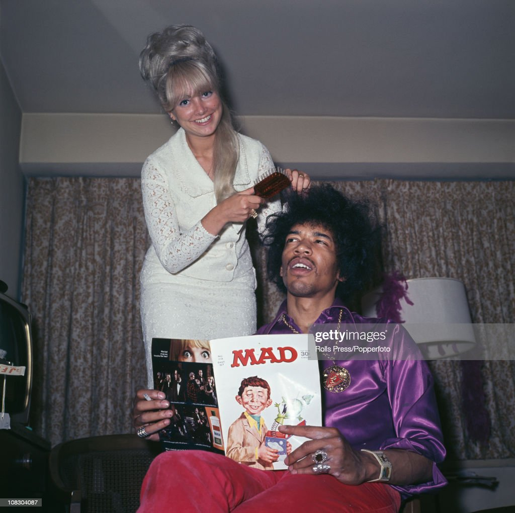 Jimi Hendrix having his hair done by a blonde lady while reading 'Mad' magazine circa 1968