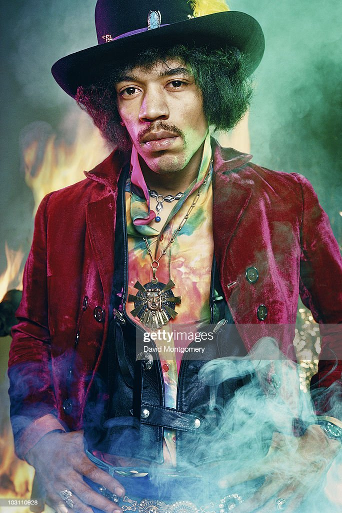 <a gi-track='captionPersonalityLinkClicked' href=/galleries/search?phrase=Jimi+Hendrix&family=editorial&specificpeople=234815 ng-click='$event.stopPropagation()'>Jimi Hendrix</a> photographed among smoke and flames for his album 'Electric Ladyland', London, 1968.
