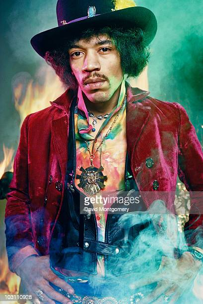 Jimi Hendrix photographed among smoke and flames for his album 'Electric Ladyland' London 1968