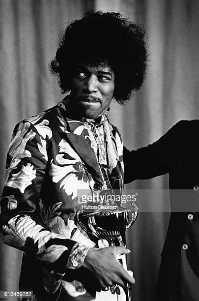 Jimi Hendrix Receives Award Photo shows Jimi Hendrix receiving an award for most popular male singer