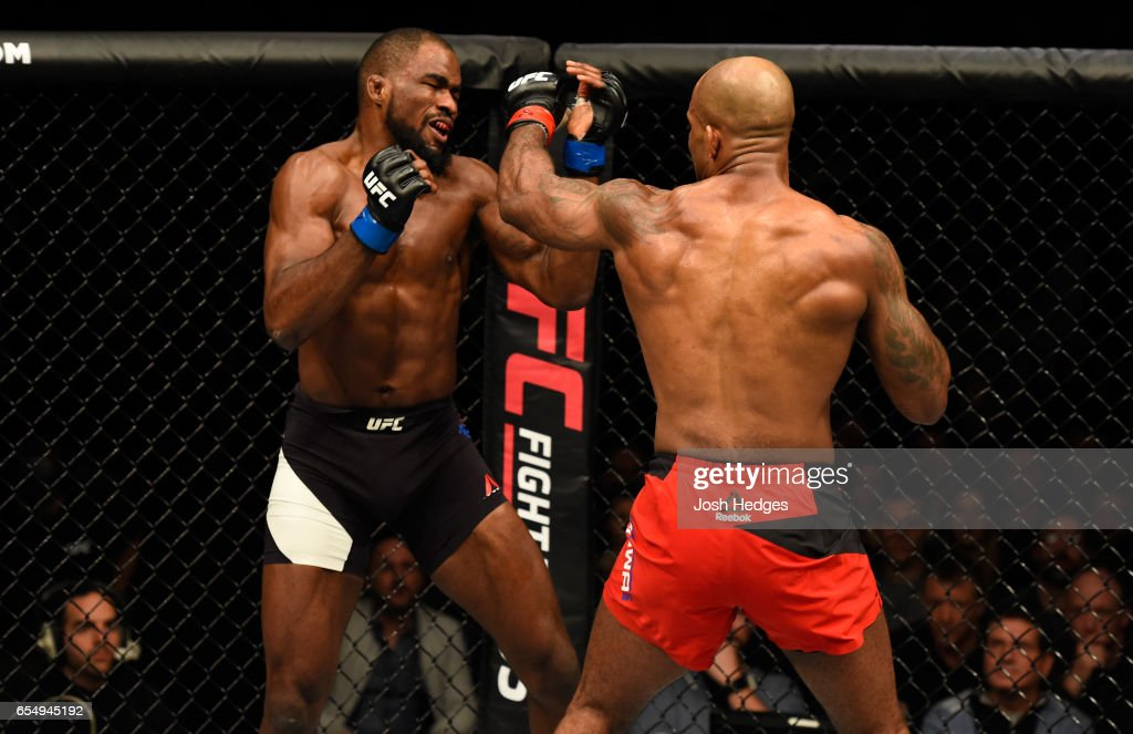 Jimi Manuwa of England punches Corey Anderson in their light heavyweight fight during the UFC Fight Night event at The O2 arena on March 18, 2017 in London, England.