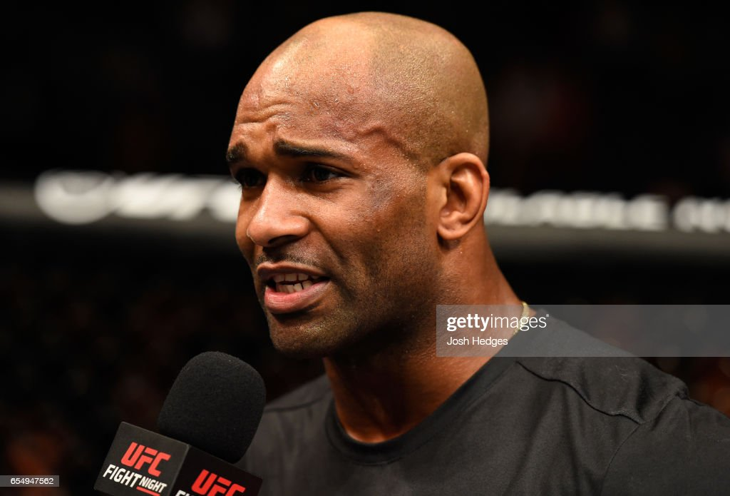 Jimi Manuwa of England speaks with Dan Hardy after his knockout victory over Corey Anderson in their light heavyweight fight during the UFC Fight Night event at The O2 arena on March 18, 2017 in London, England.