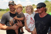 Jimi Westbrook and Phillip Sweet of LBT with children backstage at the 5th annual Ride for a Cure Afternoon Jam hosted by Little Big Town on the...