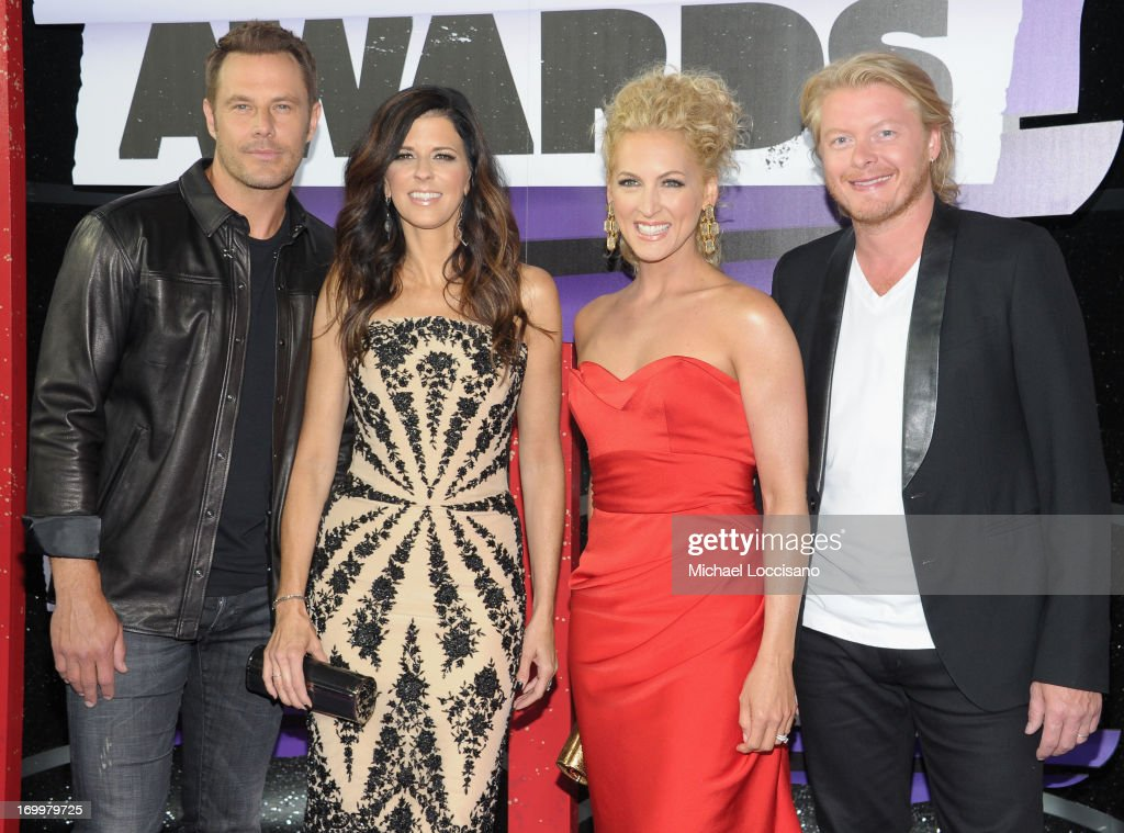 Jimi Westbrook Karen Fairchild Kimberly Schlapman and Philip Sweet of Little Big Town attend the 2013 CMT Music awards at the Bridgestone Arena on...