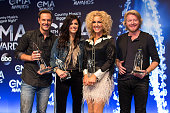 Jimi Westbrook Karen Fairchild Kimberly Schlapman and Phillip Sweet of Little Big Town win Vocal Group of the Year at the 48th annual CMA Awards at...