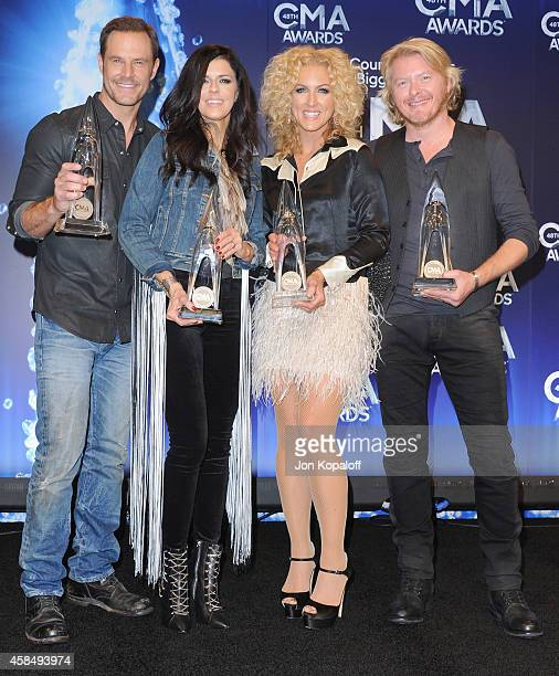 Jimi Westbrook Karen Fairchild Kimberly Schlapman and Phillip Sweet of Little Big Town pose in the press room at the 48th annual CMA Awards at the...