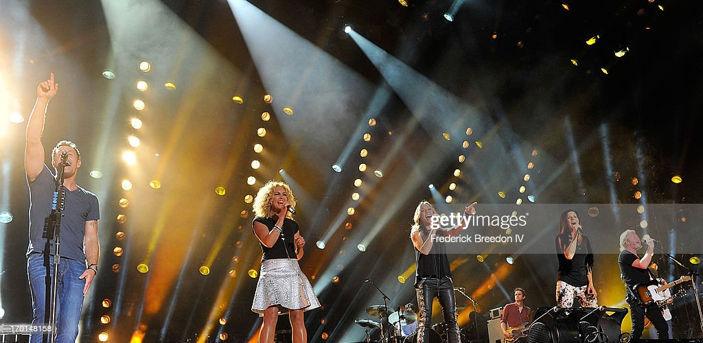 Jimi Westbrook, Kimberly Schlapman and Karen Fairchild, and Philip Sweet of the band Little Big Town perform with Sheryl Crow, center, at LP Field during the 2013 CMA Music Festival on June 7, 2013 in Nashville, Tennessee.