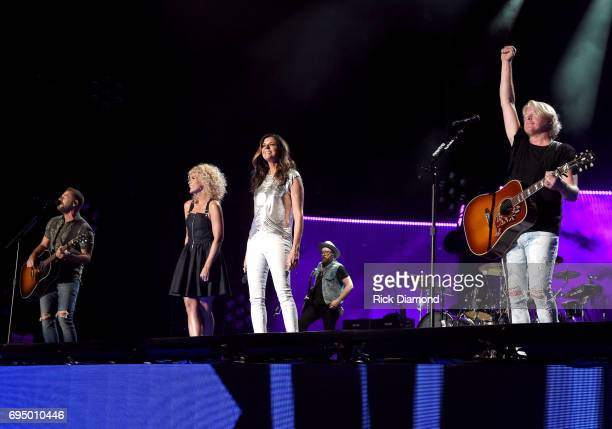 Jimi Westbrook Kimberly Schlapman Karen Fairchild and Philip Sweet of Little Big Town perform onstage during day 4 of the 2017 CMA Music Festival on...