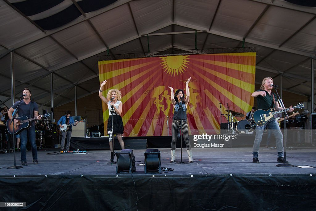 Jimi Westbrook, Kimberly Schlapman, Karen Fairchild, and Phillip Sweet of Little Big Town performs during the 2013 New Orleans Jazz & Heritage Music Festival at Fair Grounds Race Course on May 4, 2013 in New Orleans, Louisiana.