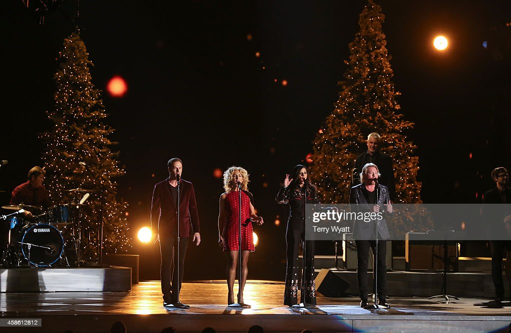 Jimi Westbrook Kimberly Schlapman Karen Fairchild and Phillip Sweet of Little Big Town perform during the CMA 2014 Country Christmas on November 7...