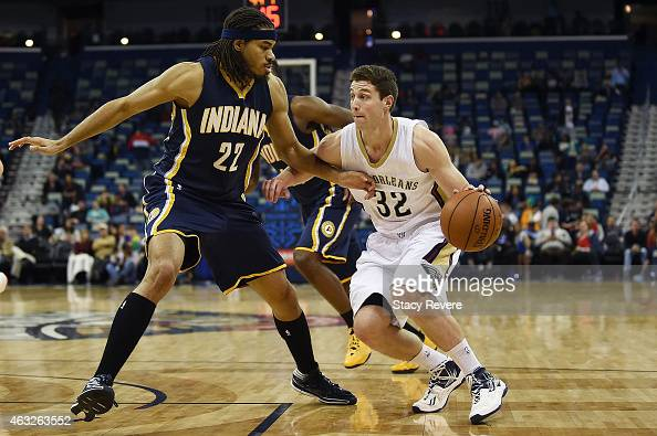 Jimmer Fredette of the New Orleans Pelicans works against Chris Copeland of the Indiana Pacers during the second half of a game at the Smoothie King...