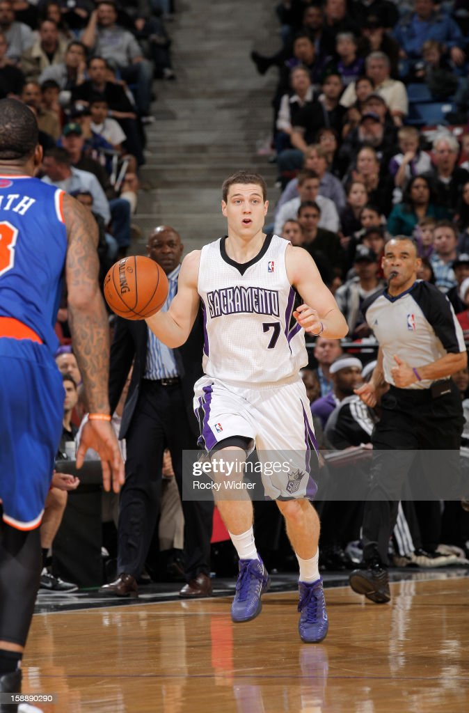 <a gi-track='captionPersonalityLinkClicked' href=/galleries/search?phrase=Jimmer+Fredette&family=editorial&specificpeople=5020564 ng-click='$event.stopPropagation()'>Jimmer Fredette</a> #7 of the Sacramento Kings brings the ball up the court against the New York Knicks on December 28, 2012 at Sleep Train Arena in Sacramento, California.