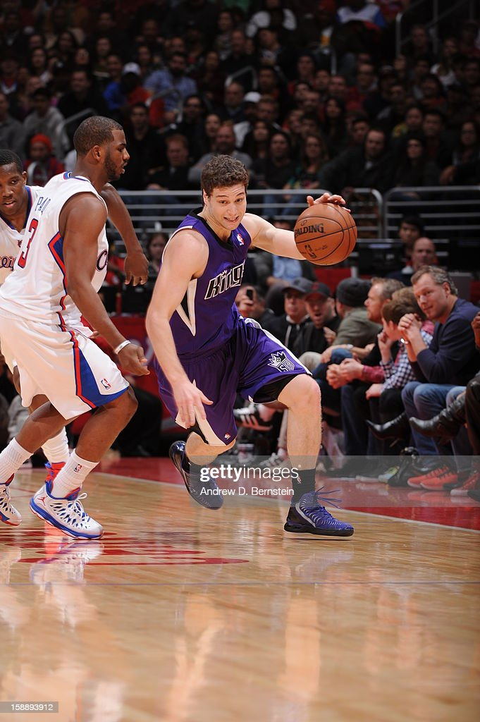 Jimmer Fredette #7 of the Sacramento Kings drives against Chris Paul #3 of the Los Angeles Clippers at Staples Center on December 21, 2012 in Los Angeles, California.