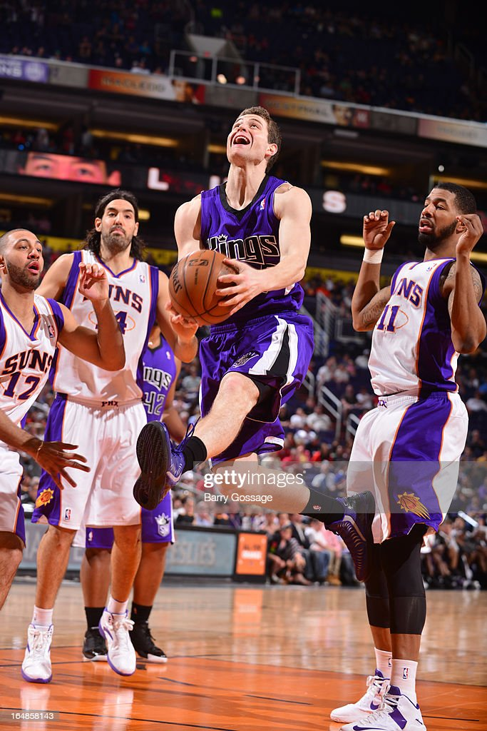 <a gi-track='captionPersonalityLinkClicked' href=/galleries/search?phrase=Jimmer+Fredette&family=editorial&specificpeople=5020564 ng-click='$event.stopPropagation()'>Jimmer Fredette</a> #7 of the Sacramento Kings drives for a shot against the Phoenix Suns on March 28, 2013 at U.S. Airways Center in Phoenix, Arizona.