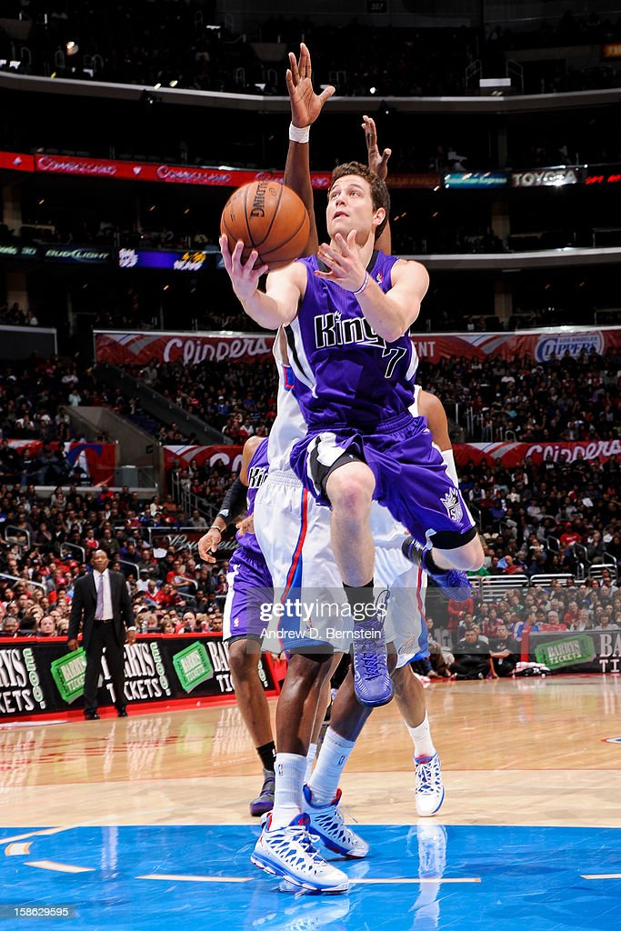 Jimmer Fredette #7 of the Sacramento Kings drives to the basket against the Los Angeles Clippers at Staples Center on December 21, 2012 in Los Angeles, California.