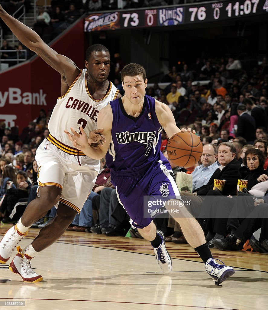Jimmer Fredette #7 of the Sacramento Kings drives to the basket against Dion Waiters #3 of the Cleveland Cavaliers at The Quicken Loans Arena on January 2, 2013 in Cleveland, Ohio.