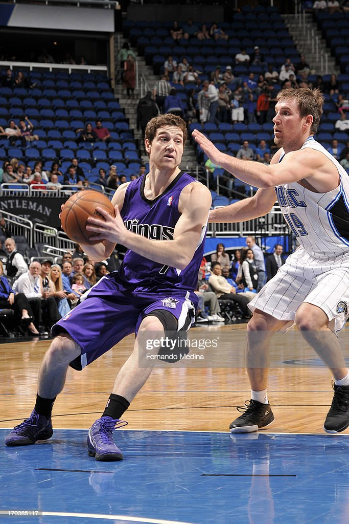 <a gi-track='captionPersonalityLinkClicked' href=/galleries/search?phrase=Jimmer+Fredette&family=editorial&specificpeople=5020564 ng-click='$event.stopPropagation()'>Jimmer Fredette</a> #7 of the Sacramento Kings drives to the basket against <a gi-track='captionPersonalityLinkClicked' href=/galleries/search?phrase=Beno+Udrih&family=editorial&specificpeople=202616 ng-click='$event.stopPropagation()'>Beno Udrih</a> #19 of the Orlando Magic on February 27, 2013 at Amway Center in Orlando, Florida.