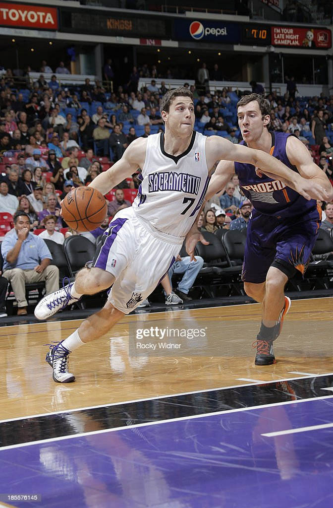 Jimmer Fredette #7 of the Sacramento Kings drives towards the hoop against Goran Dragic #1 of the Phoenix Suns on October 17, 2013 at Sleep Train Arena in Sacramento, California.