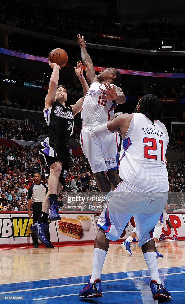 Jimmer Fredette #7 of the Sacramento Kings goes for a jump shot against Eric Bledsoe #12 of the Los Angeles Clippers during the game between the Los Angeles Clippers and the Sacramento Kings at Staples Center on December 1, 2012 in Los Angeles, California.