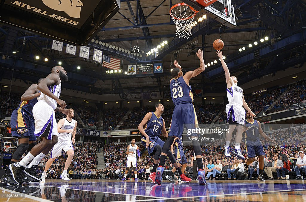<a gi-track='captionPersonalityLinkClicked' href=/galleries/search?phrase=Jimmer+Fredette&family=editorial&specificpeople=5020564 ng-click='$event.stopPropagation()'>Jimmer Fredette</a> #7 of the Sacramento Kings puts up a shot against Anthony Davis #23 of the New Orleans Pelicans on December 23, 2013 at Sleep Train Arena in Sacramento, California.