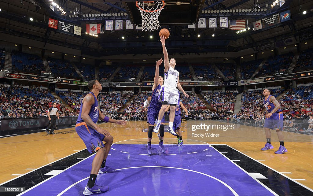 <a gi-track='captionPersonalityLinkClicked' href=/galleries/search?phrase=Jimmer+Fredette&family=editorial&specificpeople=5020564 ng-click='$event.stopPropagation()'>Jimmer Fredette</a> #7 of the Sacramento Kings shoots a layup against <a gi-track='captionPersonalityLinkClicked' href=/galleries/search?phrase=Alex+Len&family=editorial&specificpeople=8529173 ng-click='$event.stopPropagation()'>Alex Len</a> #21 of the Phoenix Suns on October 17, 2013 at Sleep Train Arena in Sacramento, California.