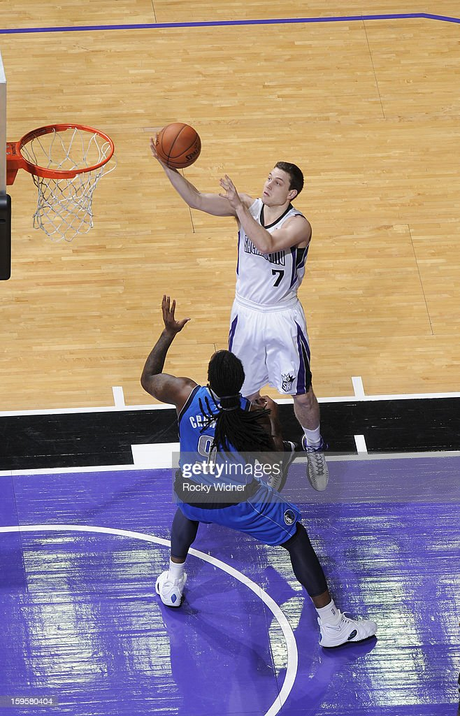 Jimmer Fredette #7 of the Sacramento Kings shoots against Jae Crowder #9 of the Dallas Mavericks on January 10, 2013 at Sleep Train Arena in Sacramento, California.