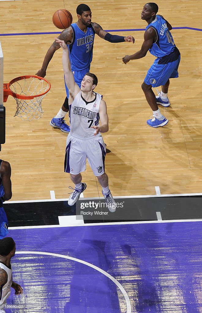 Jimmer Fredette #7 of the Sacramento Kings shoots against the Dallas Mavericks on January 10, 2013 at Sleep Train Arena in Sacramento, California.