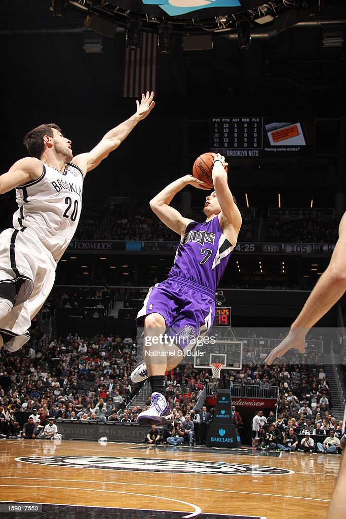 <a gi-track='captionPersonalityLinkClicked' href=/galleries/search?phrase=Jimmer+Fredette&family=editorial&specificpeople=5020564 ng-click='$event.stopPropagation()'>Jimmer Fredette</a> #7 of the Sacramento Kings shoots against <a gi-track='captionPersonalityLinkClicked' href=/galleries/search?phrase=Tornike+Shengelia&family=editorial&specificpeople=8205152 ng-click='$event.stopPropagation()'>Tornike Shengelia</a> #20 of the Brooklyn Nets on January 5, 2013 at the Barclays Center in the Brooklyn borough of New York City.