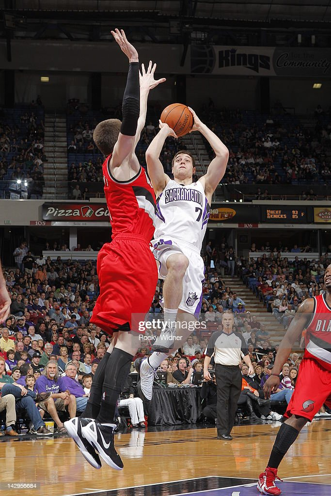 <a gi-track='captionPersonalityLinkClicked' href=/galleries/search?phrase=Jimmer+Fredette&family=editorial&specificpeople=5020564 ng-click='$event.stopPropagation()'>Jimmer Fredette</a> #7 of the Sacramento Kings shoots the ball against <a gi-track='captionPersonalityLinkClicked' href=/galleries/search?phrase=Luke+Babbitt&family=editorial&specificpeople=5122155 ng-click='$event.stopPropagation()'>Luke Babbitt</a> #8 of the Portland Trail Blazers on April 15, 2012 at Power Balance Pavilion in Sacramento, California.