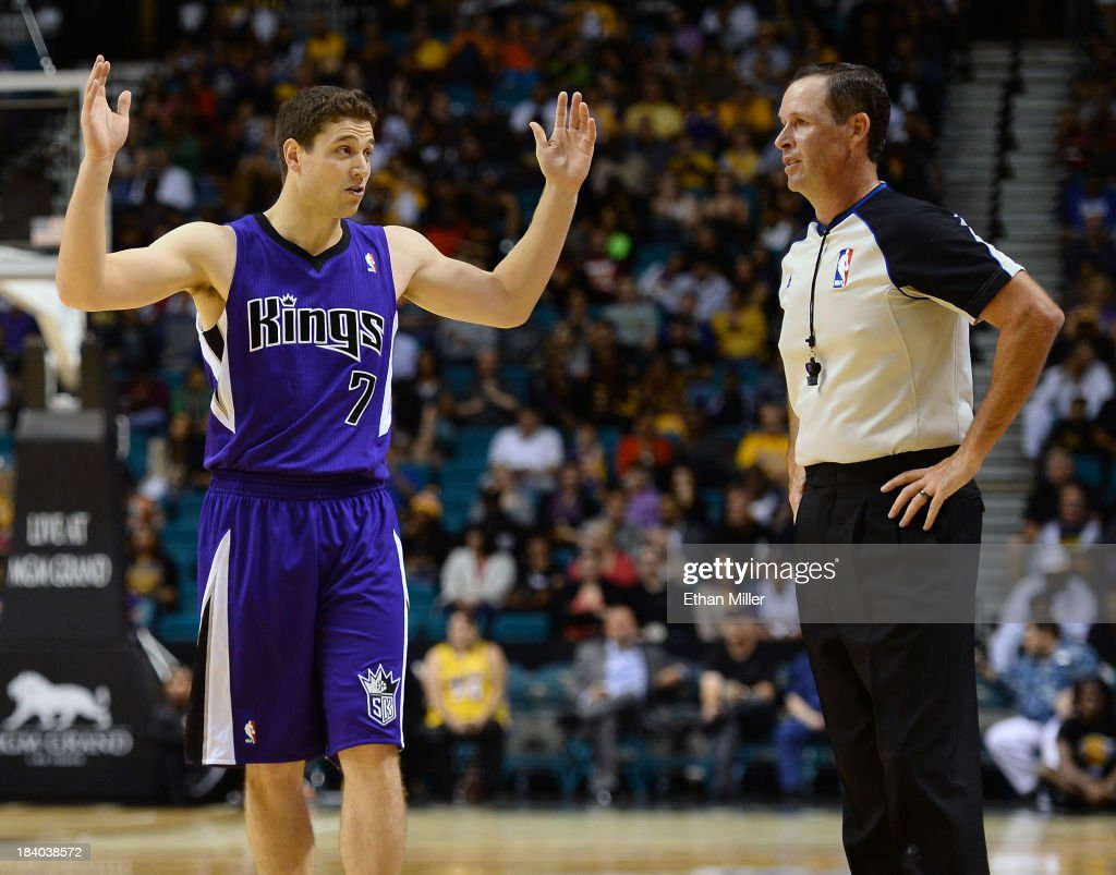 Jimmer Fredette #7 of the Sacramento Kings talks to an official after being called for a foul against the Los Angeles Lakers during their preseason game at the MGM Grand Garden Arena on October 10, 2013 in Las Vegas, Nevada. Sacramento won 104-86.