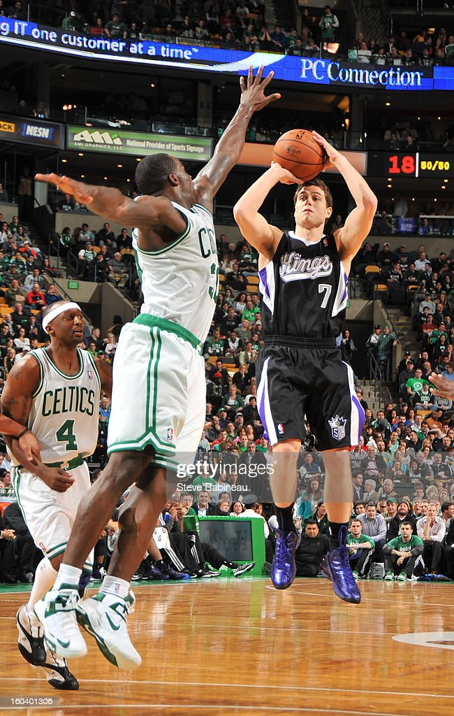 <a gi-track='captionPersonalityLinkClicked' href=/galleries/search?phrase=Jimmer+Fredette&family=editorial&specificpeople=5020564 ng-click='$event.stopPropagation()'>Jimmer Fredette</a> #7 the Sacramento Kings shoots the ball against <a gi-track='captionPersonalityLinkClicked' href=/galleries/search?phrase=Brandon+Bass&family=editorial&specificpeople=233806 ng-click='$event.stopPropagation()'>Brandon Bass</a> #30 of the Boston Celtics on January 30, 2013 at the TD Garden in Boston, Massachusetts.