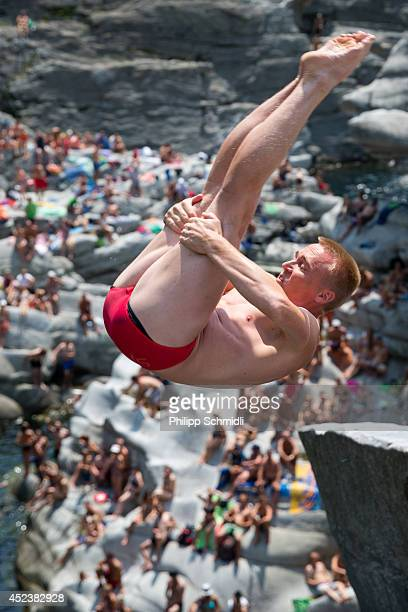 Jimmi Andersen of Denmark dives from a 20 metre rock during the Cliff Diving European Championship on July 19 2014 in Ponte Brolla near Locarno...
