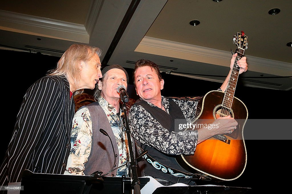 Jimmie Dale Gilmore, Butch Hancock and <a gi-track='captionPersonalityLinkClicked' href=/galleries/search?phrase=Joe+Ely&family=editorial&specificpeople=4279001 ng-click='$event.stopPropagation()'>Joe Ely</a> of the Flatlanders perform during the Nobelity Projects Artists & Filmmakers Dinner honoring Kris Kristofferson with the Feed The Peace award at the Four Seasons Hotel on February 10, 2013 in Austin, Texas.