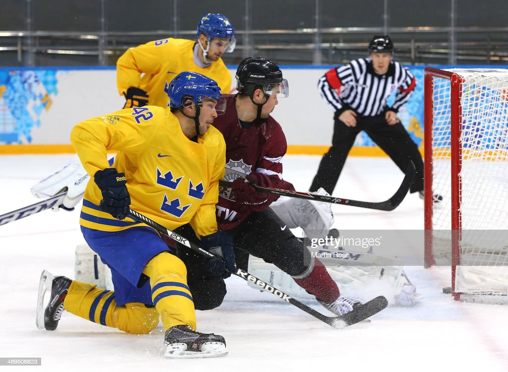 Jimmie Ericsson #42 of Sweden scores against Kristers Gudlevskis #50 of Latvia in the second period during the Men's Ice Hockey Preliminary Round Group C game on day eight of the Sochi 2014 Winter Olympics at Shayba Arena on February 15, 2014 in Sochi, Russia.