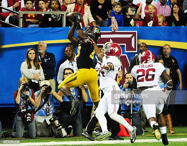Jimmie Hunt of the Missouri Tigers completes a reception against the defense of Geno Smith of the Alabama Crimson Tide in the second quarter of the...