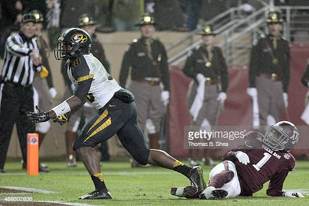 Jimmie Hunt of the Missouri Tigers is called for pass interference against Brandon Williams of the Texas AM Aggies in a NCAA football game on...