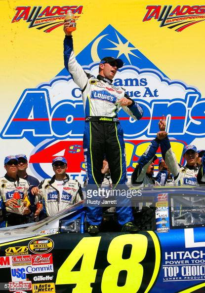 Jimmie Johnson driver of Lowe's Chevrolet poses for photographers after winning the NASCAR Nextel Cup Series Aaron's 499 at the Talladega...
